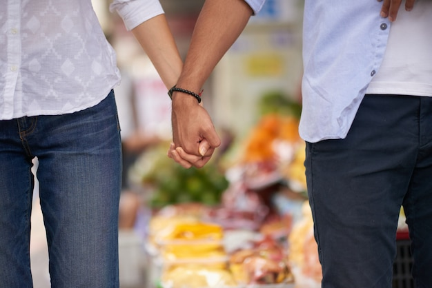 Lovers holding hands Free Photo