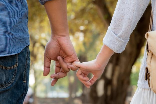 Lovers walking hand in hand Premium Photo