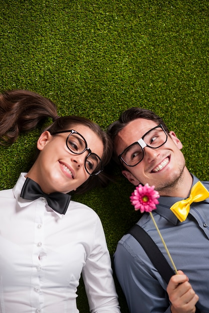Loving couple lying down on the grass Free Photo