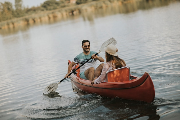 Loving couple rowing on the lake Photo | Premium Download