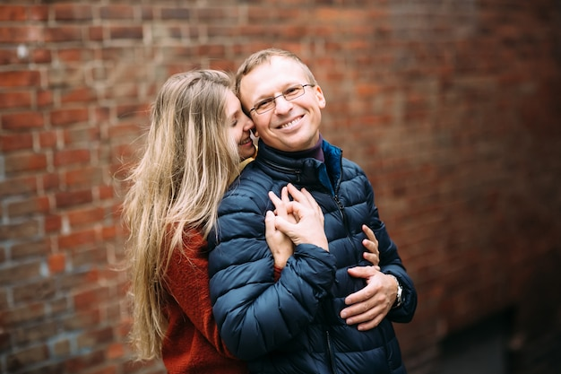 Loving couple of tourists walking around old town.. vacation, autumn, holiday, tourism: concept. Premium Photo