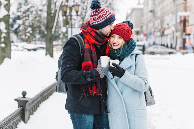 Loving couple walking in winter city Free Photo