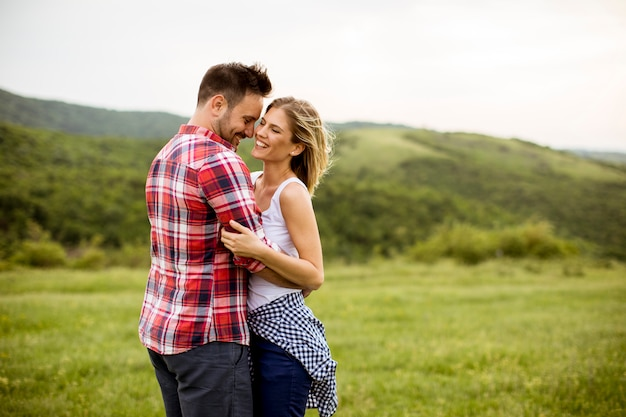 Loving embracing coulpe having fun in the spring nature Premium Photo