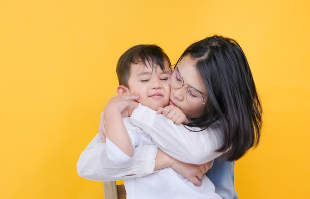 Loving mother and son hugging Premium Photo