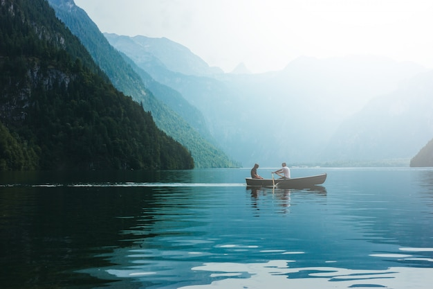 Loving young couple in boat at lake. date walk man and woman in ...