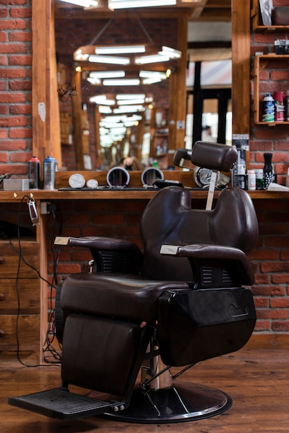 Low angle barber shop with leather chair Free Photo