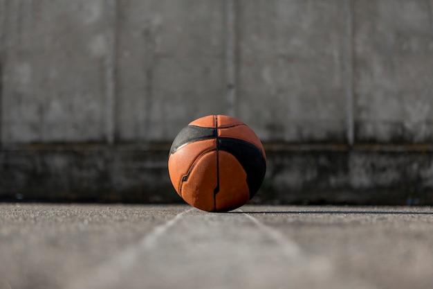 Low angle basketball on asphalt Free Photo