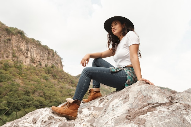 Low angle female explorer on rocks Free Photo