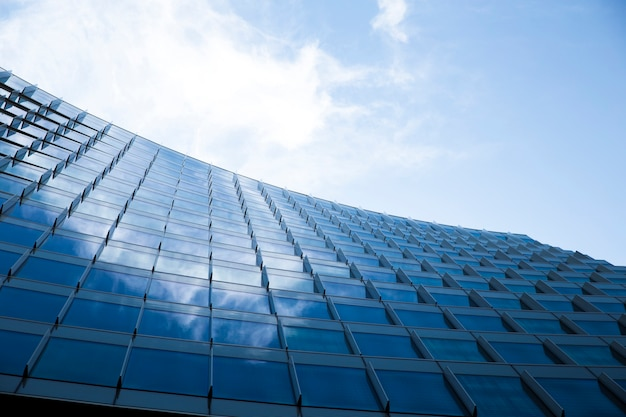 Low angle modern design glass building Free Photo