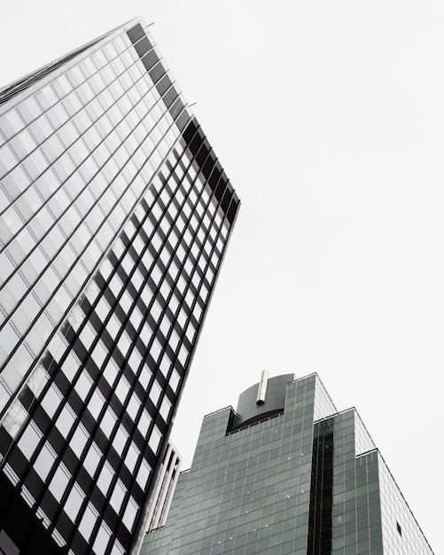 Low angle modern glass buildings Free Photo