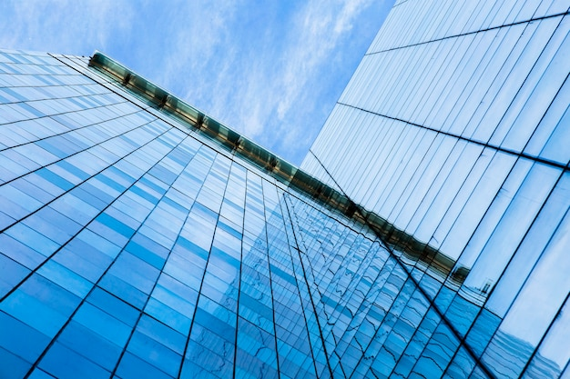 Low angle modern glass skyscrapers Free Photo