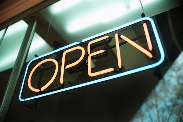 Low angle open sign Free Photo