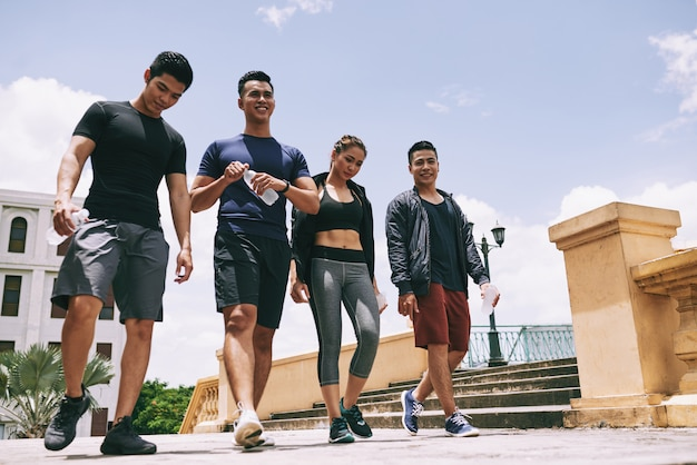 Low angle shot of athletic team walking outdoors after the joint workout Free Photo