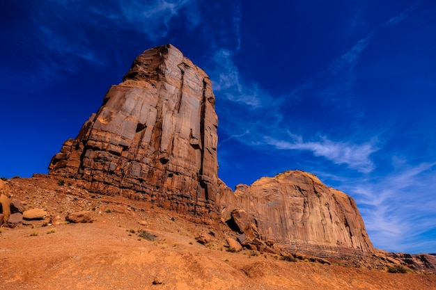 Low angle shot of big desert rocks with blue sky in the background Free Photo