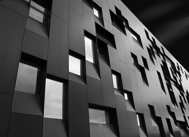 Low angle  shot of a creative modern building with outstanding architectural twists Free Photo