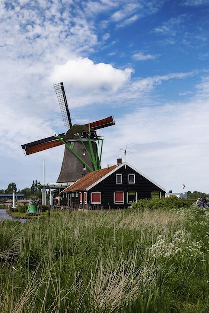 Low angle shot of windmills in zaanse schans neighborhood Free Photo