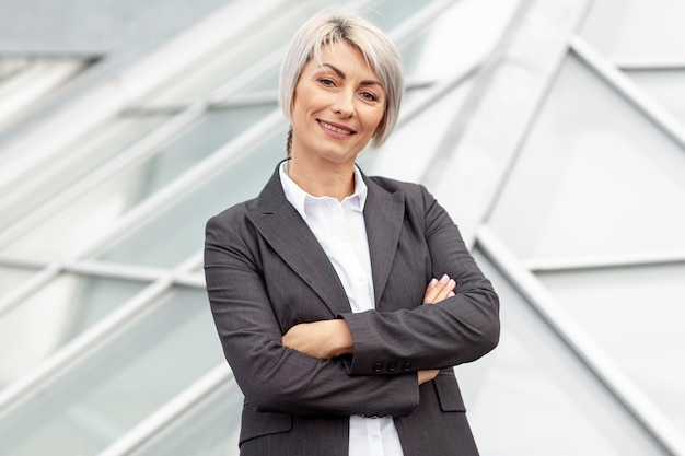 Low angle smiley business woman Free Photo