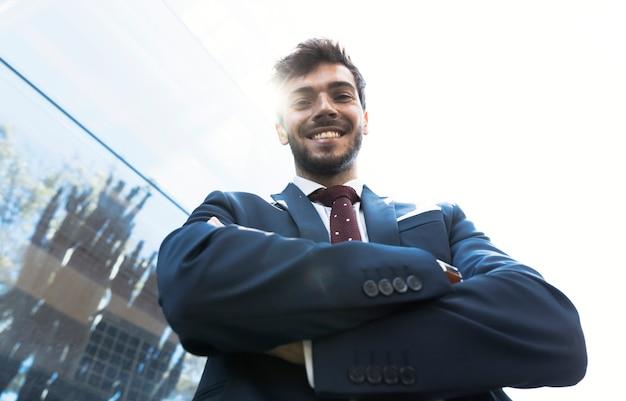 Low angle smiley man looking at camera Free Photo