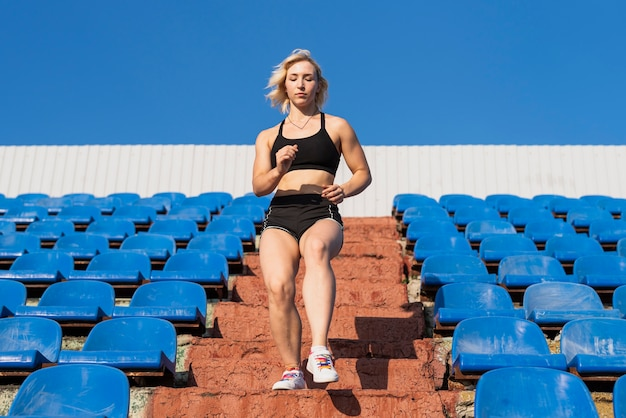 Low angle sportive woman stairs exercising Free Photo