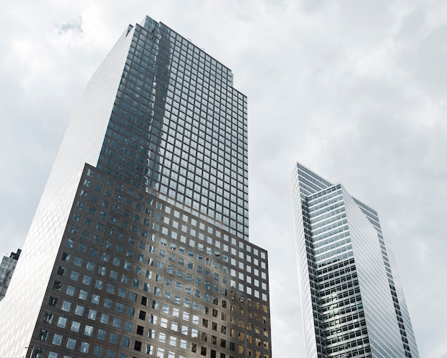 Low angle tall buildings with grey clouds Free Photo