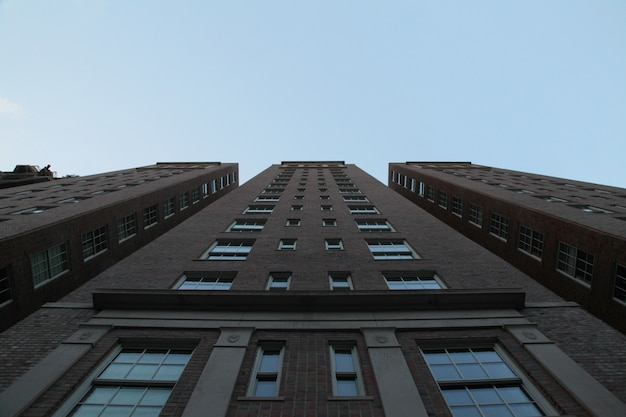 Low angle upshot of a tall architecture with blue sky Free Photo