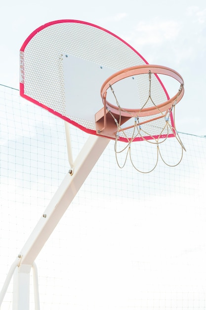 Low angle view of a basketball hoop at outdoors Free Photo