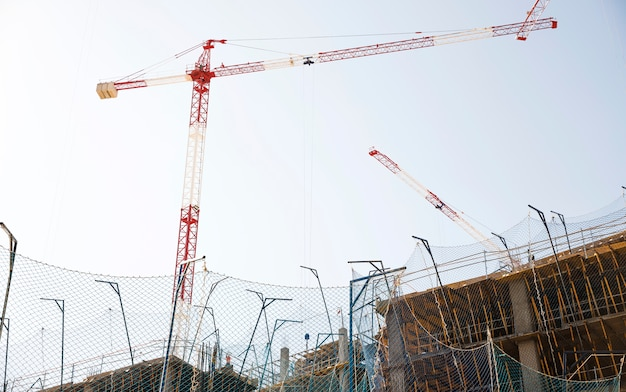 Low angle view of construction site against blue sky Free Photo