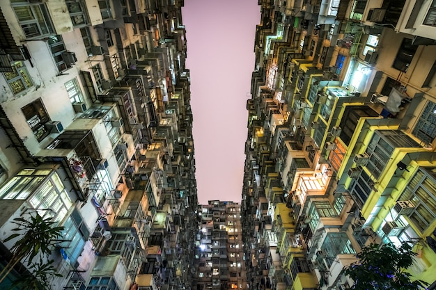 Low angle view of crowded residential towers in old community in quarry bay, hong kong. scenery of overcrowded narrow apartments, a phenomenon of high housing density & housing blues in hongkong Premium Photo