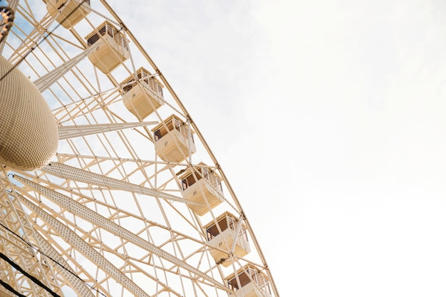 Low angle view of large ferris wheel against clear sky Free Photo
