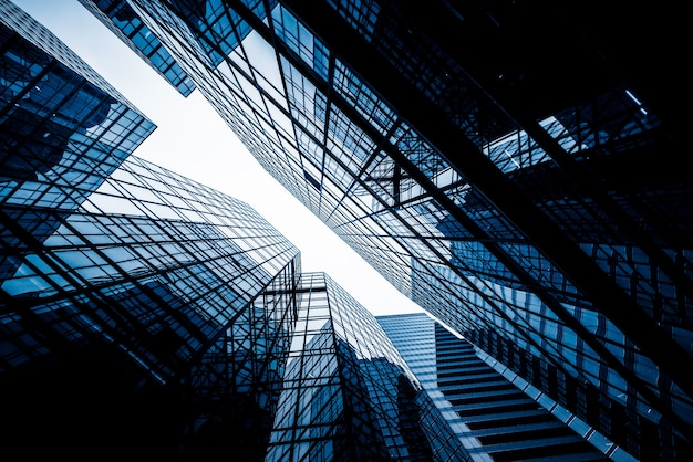 Low Angle View To Light Glass Buildings Of Business Center: Low Angle View Of Skyscrapers Photo