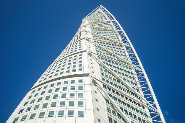 Low angle view of the turning torso under a blue sky and sunlight in malmo in sweden Free Photo