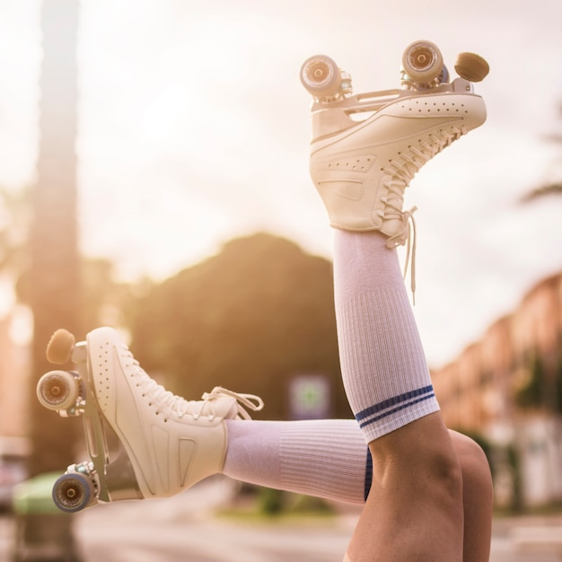 Low angle view of woman's leg wearing vintage roller skates Free Photo