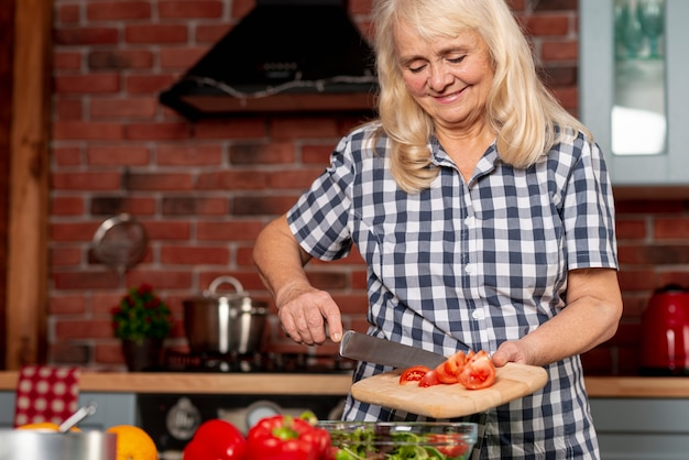 Low angle woman cooking healthy food Free Photo