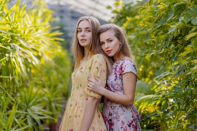 Low angle women posing in foliage middle Free Photo