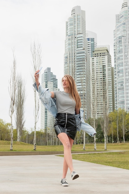 Low angle young woman taking selfie Free Photo