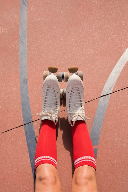 Low section of a female skater with red socks and roller skate Free Photo