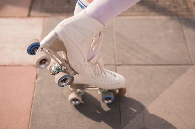 Low section of female skater with white vintage roller skate Free Photo