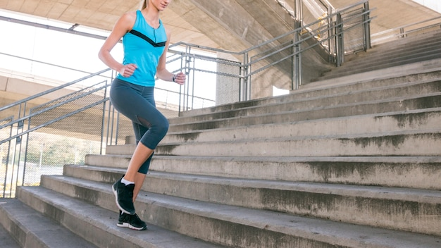 Low section of fitness young woman jogging on staircase Free Photo