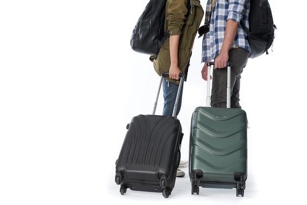 Low section of unrecognizable people with baggage and backpacks Free Photo