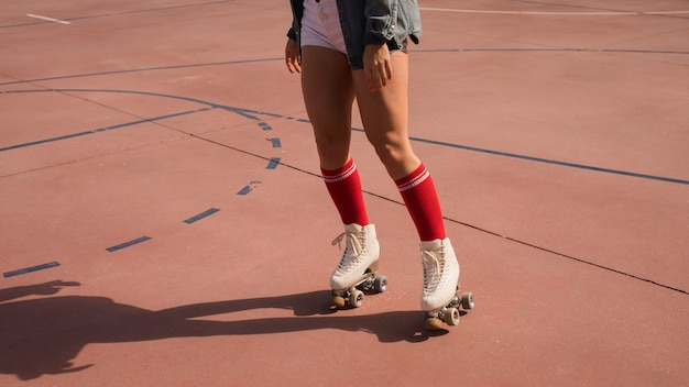 Low section of woman skating on outdoor court Free Photo