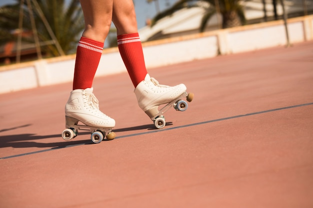Low section of a woman skating on outdoor court Free Photo