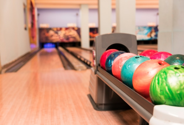 Low view colourful bowling balls Free Photo