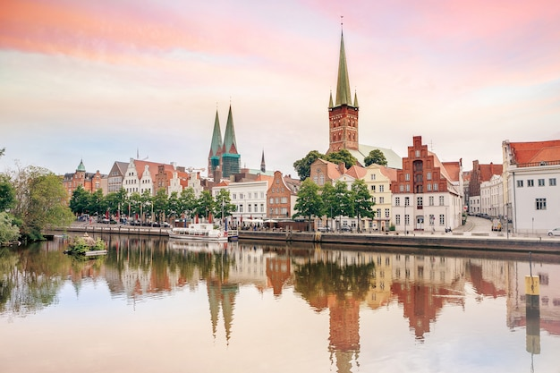 Lubeck old town reflected in trave river, germany Premium Photo