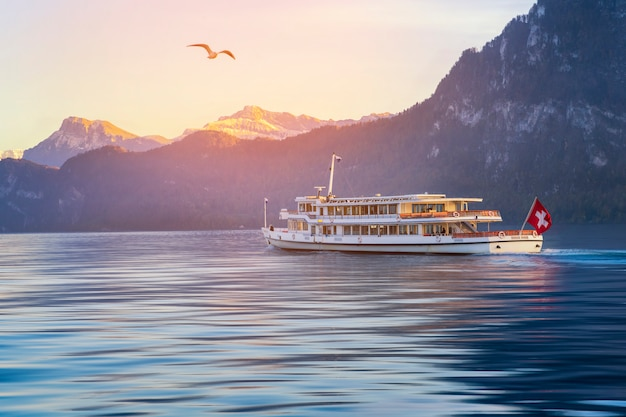 Lucerne boat tour on river with swiss mountain Premium Photo