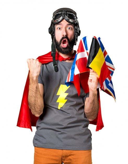 Lucky superhero with a lot of flags Free Photo