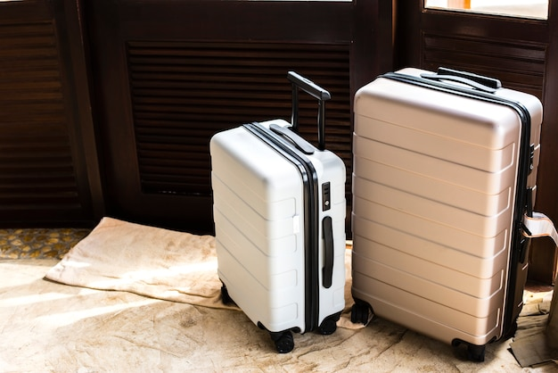 Luggage in a hotel room Free Photo