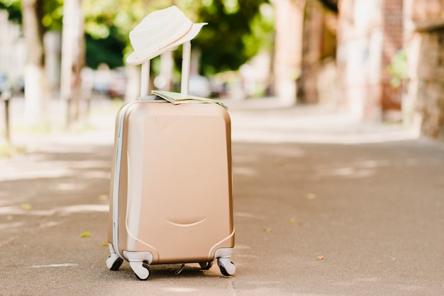Luggage standing with hat on top Free Photo