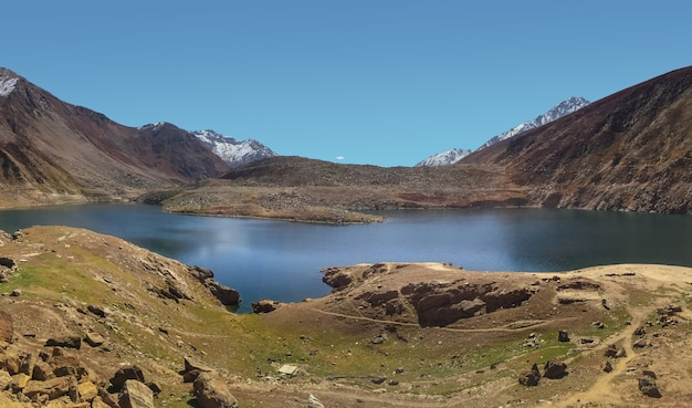 Lulusar lake with snow capped mountain range, pakistan. Premium Photo