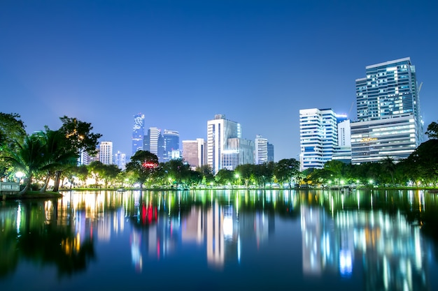 Lumpini park and bangkok city central business downtown landscape at night time Premium Photo