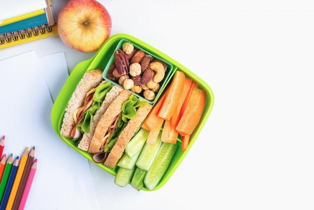 Lunch box set of ham cheese sandwich with cucumber Premium Photo